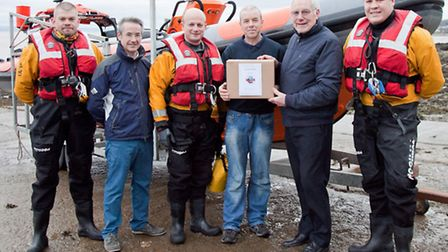 Fraser Ebbs and Mike Povey of Burleigh Portishead with crew members of Portishead's lifeboat