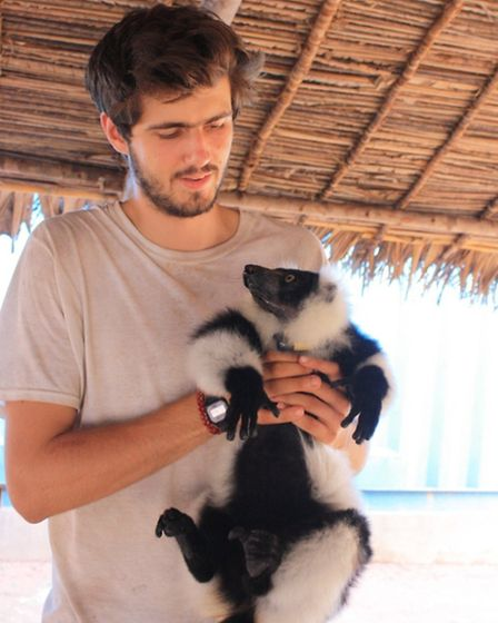 Olly Griffin with a lemur in Madagascar