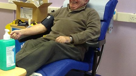 Colin Hughes giving his 150th blood donation