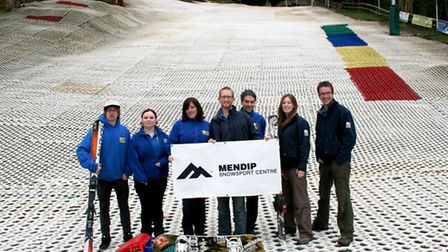 Instructors at the newly-named Mendip Snowsport Centre show off the new brand.