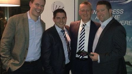 Pure Comms MD Rob Vivian (right) with the award.