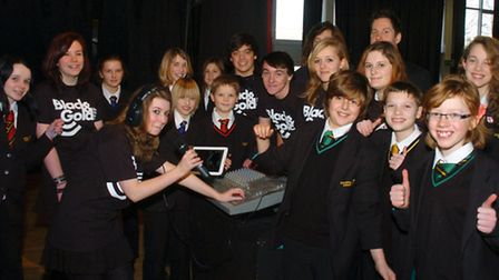 Pupils who have helped set up a school radio station called Black and Gold.