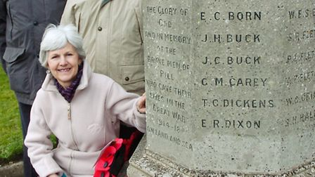 Maggi Stowers, Ivor King and Garfield Porter next to the war memorial in Pill