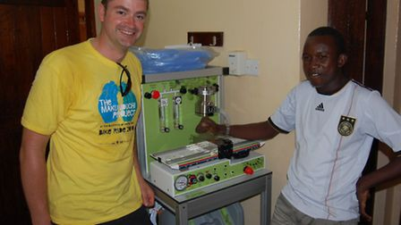 Jon Rees and nurse anaesthetist Fatawi with the Glostavent anaesthetic machine paid for by North Som