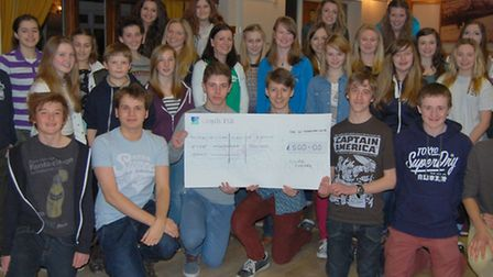 Members of CLOC Juniors with a cheque for Macmillan Cancer Support