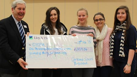 Gordano RAG cheques: (l-r) Rod Mitchell (CICRA rep), Sarah Reardon (head of committee) and Izzy Ferr