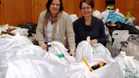 Annie Smith (Centre Manager at The Barn) and a CHSW volunteer at the Donate It Day