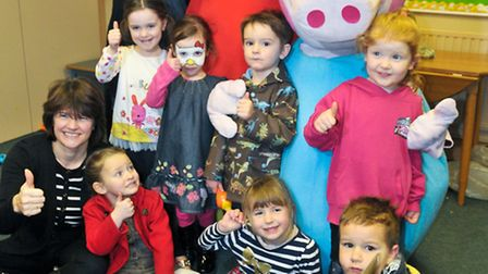 Peppa Pig visiting kids at a table top sale preschool fundraising event.