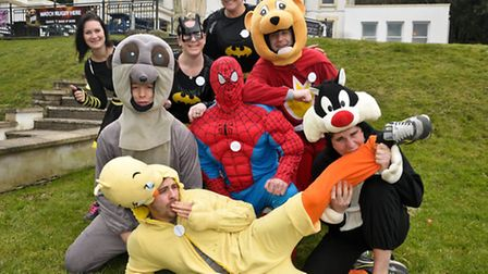 Owner of the Salthouse Andrea Searle with fancy dress runners raising money for the Make a Wish Foun