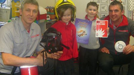 Firefighters Paul Richards and James Hailwood with pupils Caitlin and Oliver