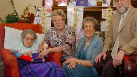 Phyllis Woodgate celebrating her 100th birthday with her son Philip and daugthers Peggy and Anne.