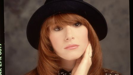 Tiffany, wearing a black hat and her hand placed on her cheek. (Photo by Lynn Goldsmith/Corbis/VCG