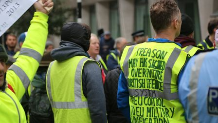 Far right yellow vests stage a protest in front of the Saint James underground station London, Engla