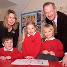 John Penrose and Alison Waite looking at the school plans with pupils