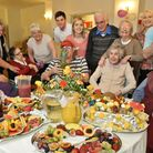 Residents and staff trying some of the tasty fruit dishes.