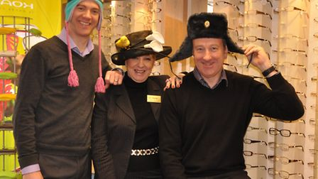 Adam Wannell, Kate Bull, and David Bull donned hats for charity. Photo: Mike Lang.