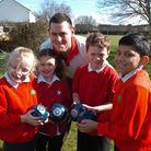 Bowls player Andrew Owens with pupils.