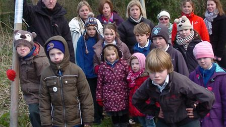 Parents and children at the entrance to the woods.