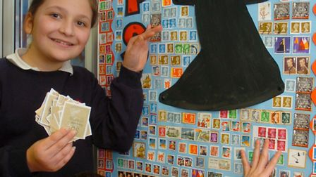 Year 4 Pupils with Huge collage they have created with stamps, Ewan and Isabelle.