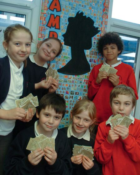 Year 4 Pupils with Huge collage they have created with stamps