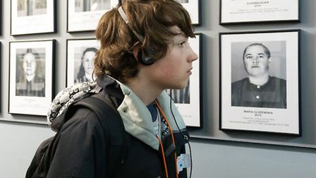 Clevedon School's Mike Stock studies photographs of some of Auschwitz's victims.