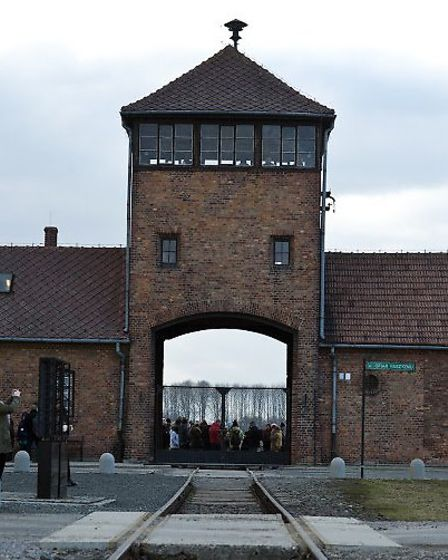 Railway lines lead beneath the Birkenau watch tower and directly to the vast camp's gas chambers.