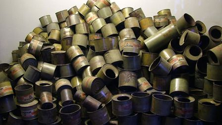 Piles of empty Zyklon B gas cannisters, the type used to murder millions.