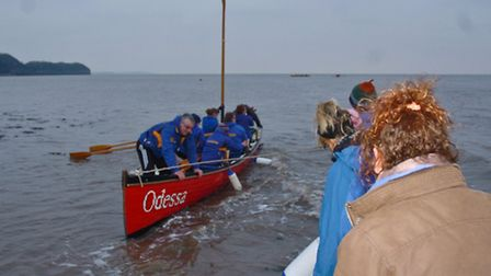 Pilot Gigs arriving at the shore.