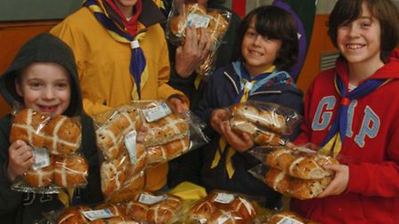 Scouts receiving hot cross buns from Pullins bakery.