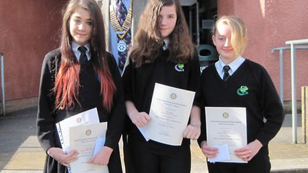 Winner Tilly Muir with highly commended Evie Steward and Amy Clay with Rotary president Jim Christop
