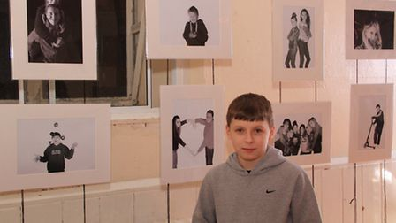 Youth club members Jack Mobbs with some of the photos on display