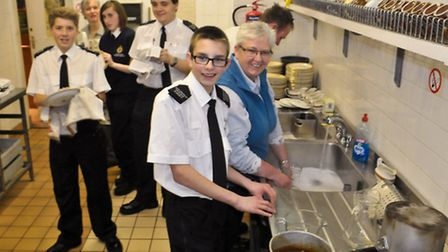 Police Cadets and volunteers in the kitchen.