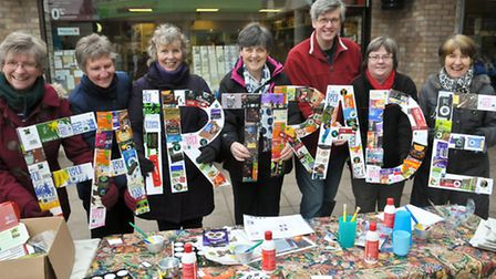 Pill Fairtrade group members have made a banner out of recycling food wrappers.