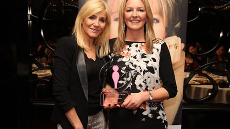 Hayley Cox being presented with the UK's Most Inspirational Mother award by Michelle Collins.
