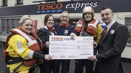 Ben Cason manager of the new Tesco Express in Portishead, right, helped by Sandra Samways area perso