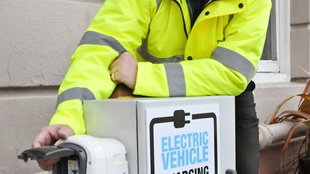 Royal Hotel, Westron. Jonathan Cooke with their new electric car charging point in the car park.