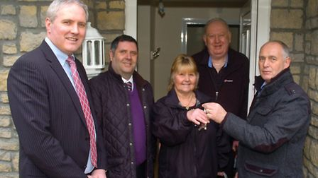 Handing the keys to the first tennets Clive and Heather Rendle are Steve Drew from Alliance Homes wi