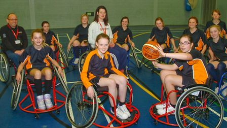 Youngsters Taking part in wheelchair Basketball.