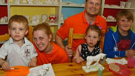 Gemma Culrooss and Kevin Bindging with children.