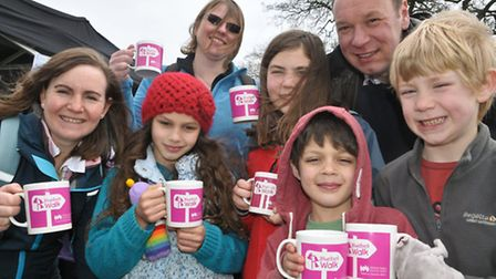 The Pai and Carveth families with their mugs after the Bluebell Walk.