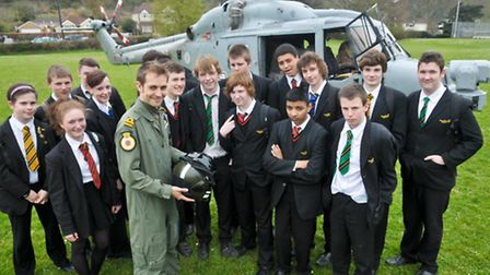 Pupils meeting the crew Lt Adam Rudkin and looking around the helicopter.