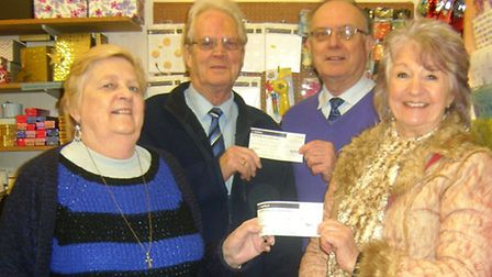 Rosemary and Matt Westley presenting cheques to Angela Cooper of Portishead in Bloom and Dave Skelho