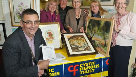 Lions President Alan Harker with Lions (organiser) Daisy Inger, Rob and Maureen Gemmell and some art