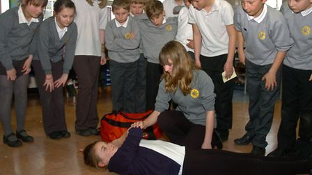 Year Six pupils taking part in first aid training.
