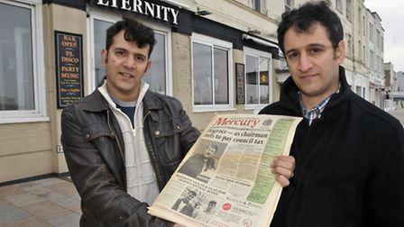 Louis and Andrew Macrides outside Eternity Bar with a Mercury front page about their opening 20 year