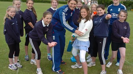 England captain Charlote Edwards and International Heather Knight and girls from Highdown and Northl
