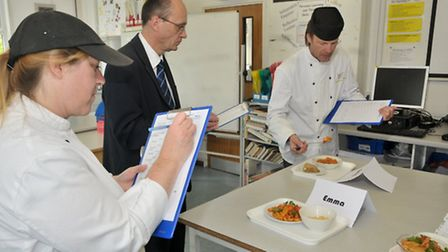 Judges tasting the dishes.