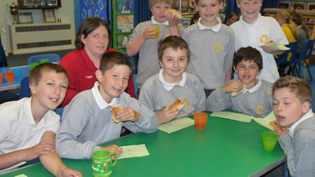 Deb Bear, from Tesco in Nailsea, enjoying breakfast with year six pupils from Golden Valley Primary
