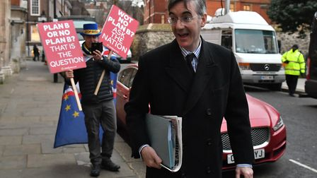 Jacob Rees-Mogg in Westminster with an anti-Brexit protestor. Photograph: Dominic Lipinski/PA.