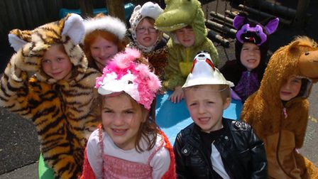 Children in animal fancy dress costumes.